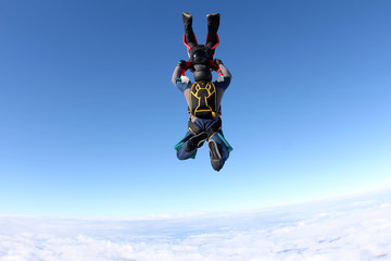 Two skydivers gripped each other