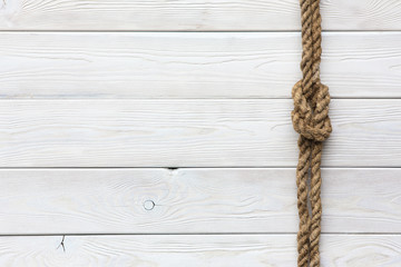 White wooden background, ship rope, sea knot, ship deck