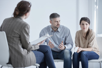 Family therapist and unhappy couple