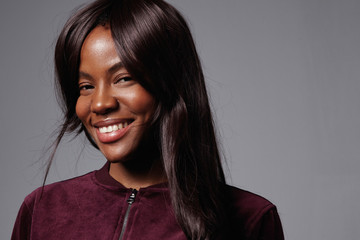 happy smiling black woman with long straight hair