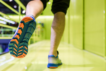 Running sport. Man runner legs and shoes in action at sport shop.