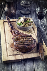 Barbecue Wagyu Tomahawk Steak as close-up on Cutting Board