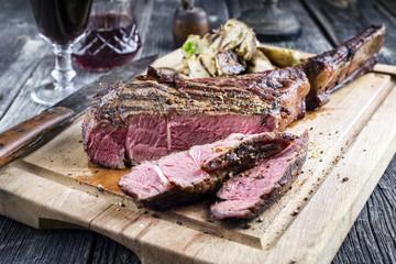 Barbecue Wagyu Tomahawk Steak sliced on Cutting Board