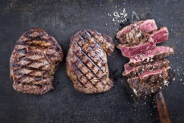 Tree Barbecue Wagyu Entrecote Steaks as top view on old Metall Sheet