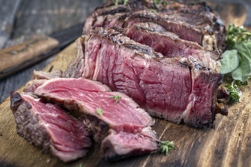 Barbecue aged Entrecote Steak sliced on Cutting Board