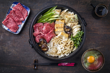 Traditional Japanese Sukiyaki in as top view Cast Iron Pot