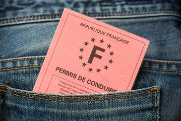 French driving license in the rear pocket of blue jeans, driving licence test concept