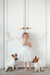 Little girl with dogs in the room