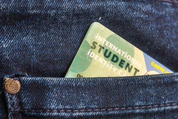 International student identity card in the rear pocket of blue jeans
