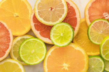 Grapefruit, lime, lemon, and orange slices background
