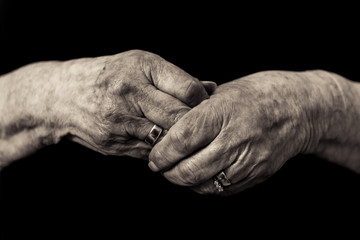 Older lady's hands. Widows grief in old age concept