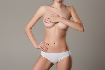 Young, slim, healthy and beautiful woman in white lingerie