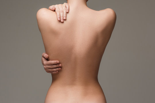 The beautiful woman's body on gray background