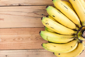 top view of banana on wooden background