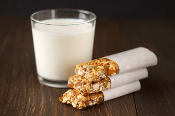 Homemade no bake granola bars with oat, dates, honey and almond on wooden background.
