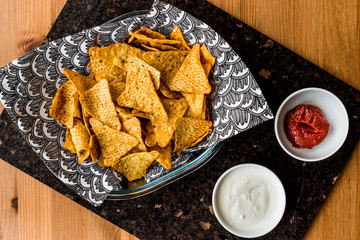 Nachos chips with salsa and sour cream dips / Yogurt Sauce..