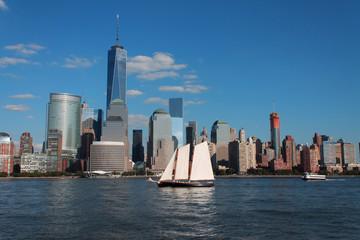 Fototapeta Lower Manhattan cityscape with sailing ship