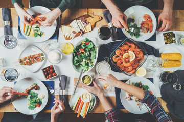 Top view of best friends dinning together, happy friends celebrating and holidays concept, Mediterranean Kitchen, festive table