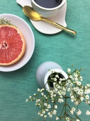 White flowers with grapefruit in background