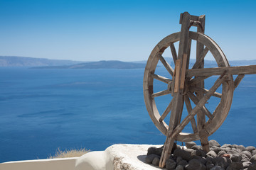 Old wooden wheel in Oia Village