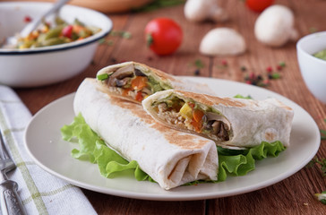 Burito with chicken mushrooms and vegetables