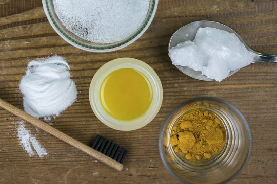 DIY toothpaste with ingredients, coconut oil, turmeric, baking soda, Xylitol and bamboo toothbrush