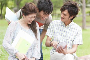 Three university students using tablet PC
