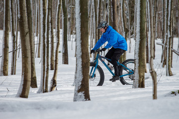 Fat biker riding in the snow