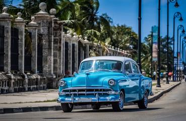 Garden Poster Cars from Cuba HDR - Blauer Oldtimer fährt auf der berühmten Promenade Malecon in Havanna Kuba - Serie Kuba Reportage