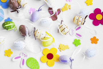 Easter eggs, bunnies, flowers and feathers decorations