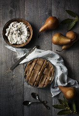 Pear an ricotta tarts on table