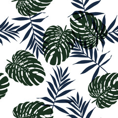 Seamless floral pattern with beautiful monstera and  palm leaves. Jungle foliage on white background. Textile design.