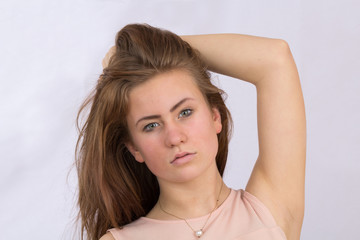 Portrait of a beautiful young girl with long hair