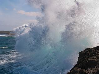 An ocean wave hits the beach - Bali, Indonesia