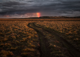 Dirt road and rainbow