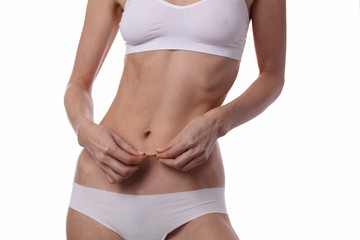 Woman measuring body fat percentage. Perfect Slim Body, waist close up. Sport, fitness, Dieting results.