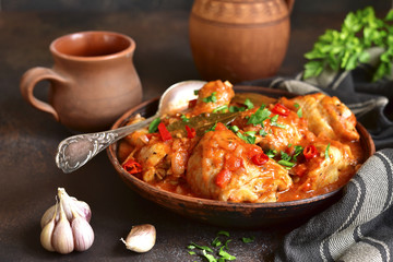 Chakhokhbili - chiken stew with garlic and cilantro (parsley) in tomato sauce.