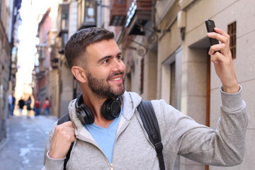 Man taking a selfie in the city