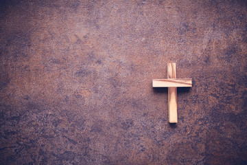 Wooden cross on dark copy space toning background