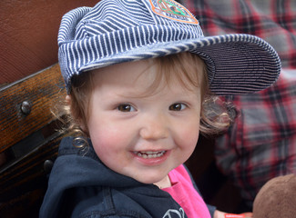 Toddler Girl with Train Conductor Hat