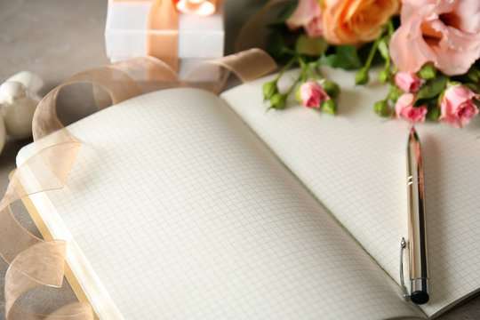 Wedding to do list with flowers on table