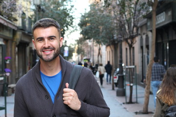 Handsome healthy man smiling in the city