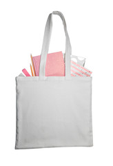Fabric bag with stationery on white background