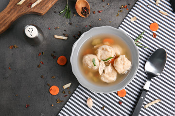 Bowl with delicious chicken and dumplings on kitchen table