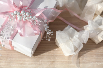 Beautiful gift boxes with bows on light background