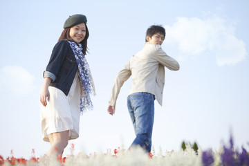 Young Couple in Field of Flowers