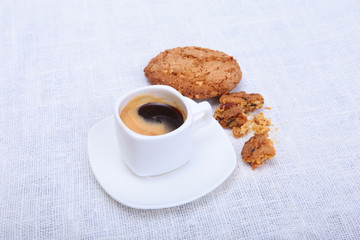 Fresh homemade muffin, cake and white cup of Cappuccino on white background.