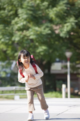 Girl with backpack at street, smiling