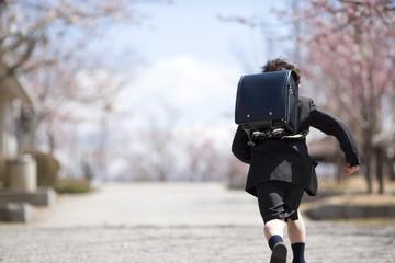 Elementary school boy running