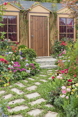 Landscaped backyard of house with flower garden